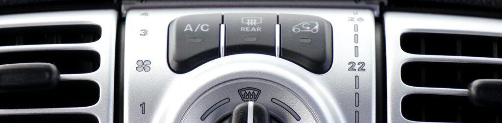 Botón de recirculación del aire acondicionado